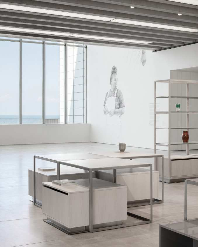 Store with panoramic view of ocean and vases on display shelves in interior designed by Daytrip