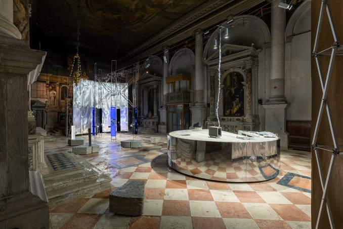 Reflective structures display objects at Planet of People