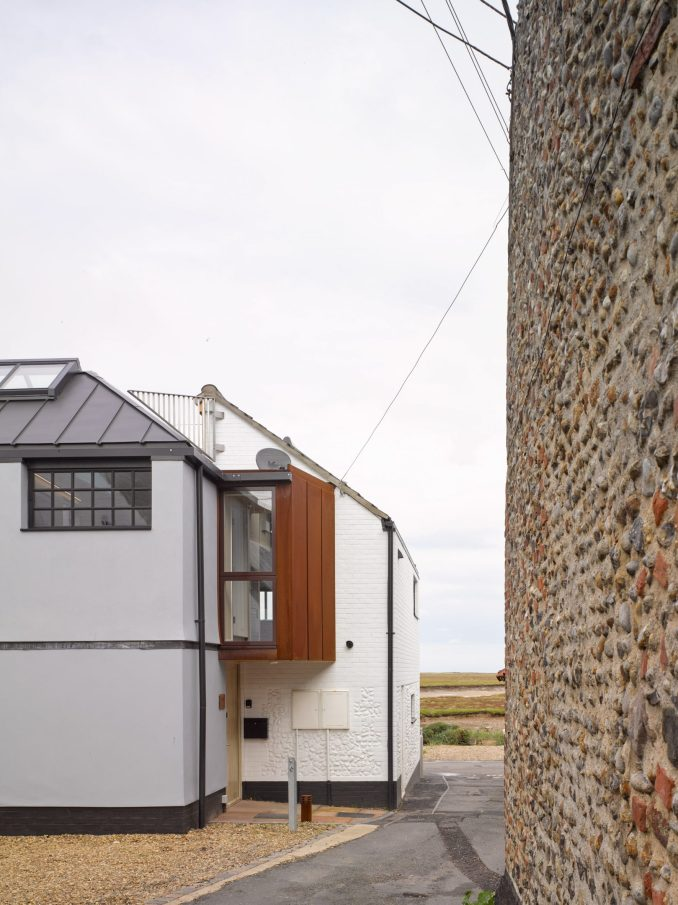 A corten volume at the rear overlooks the road