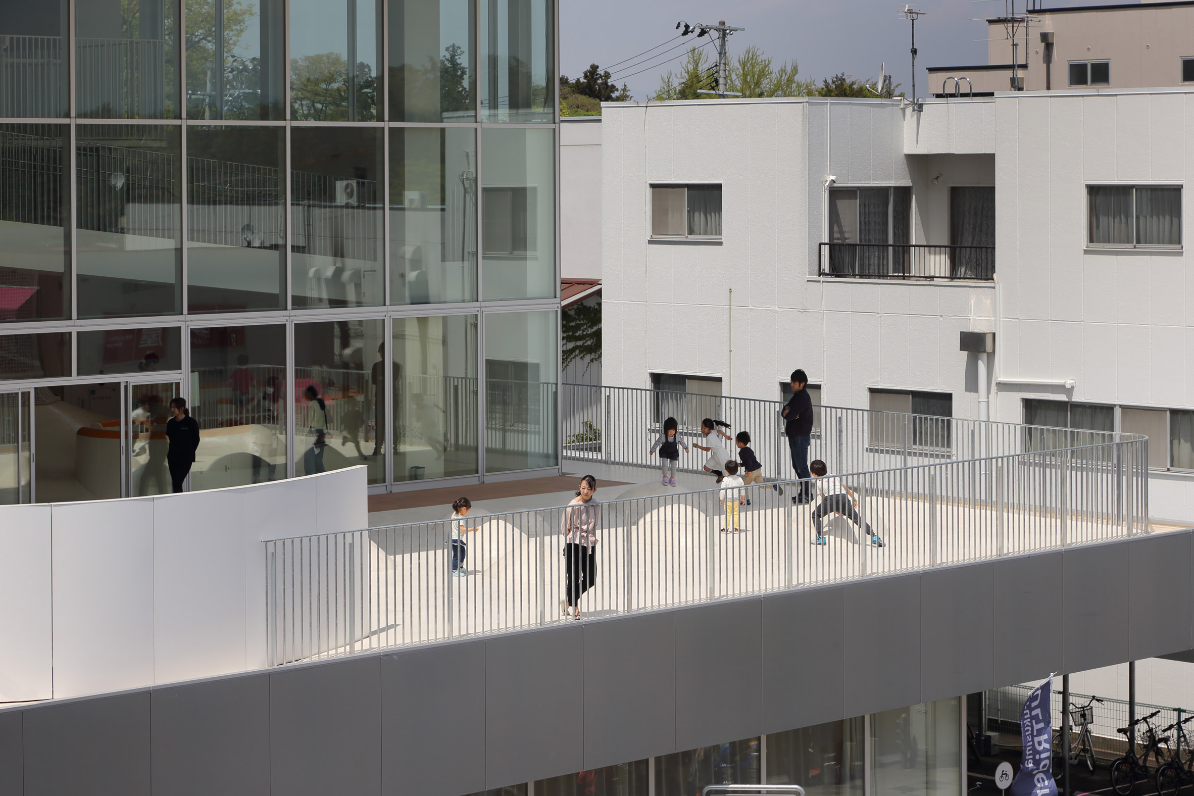 Children are pictured playing on a terrace