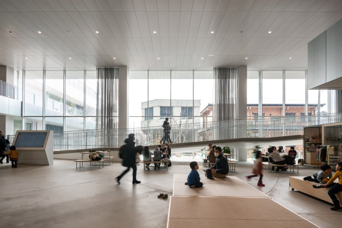 Floor-to-ceiling windows line the ground floor of The Sukagawa Community Center