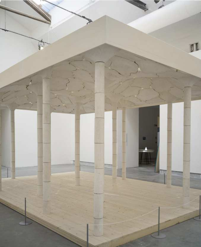 White limestone structure within a gallery