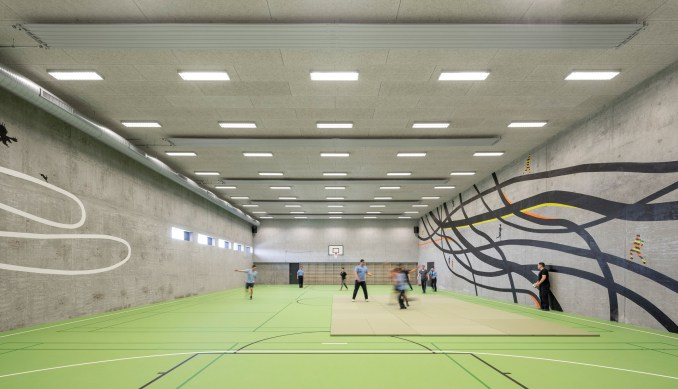A sports hall with concrete walls