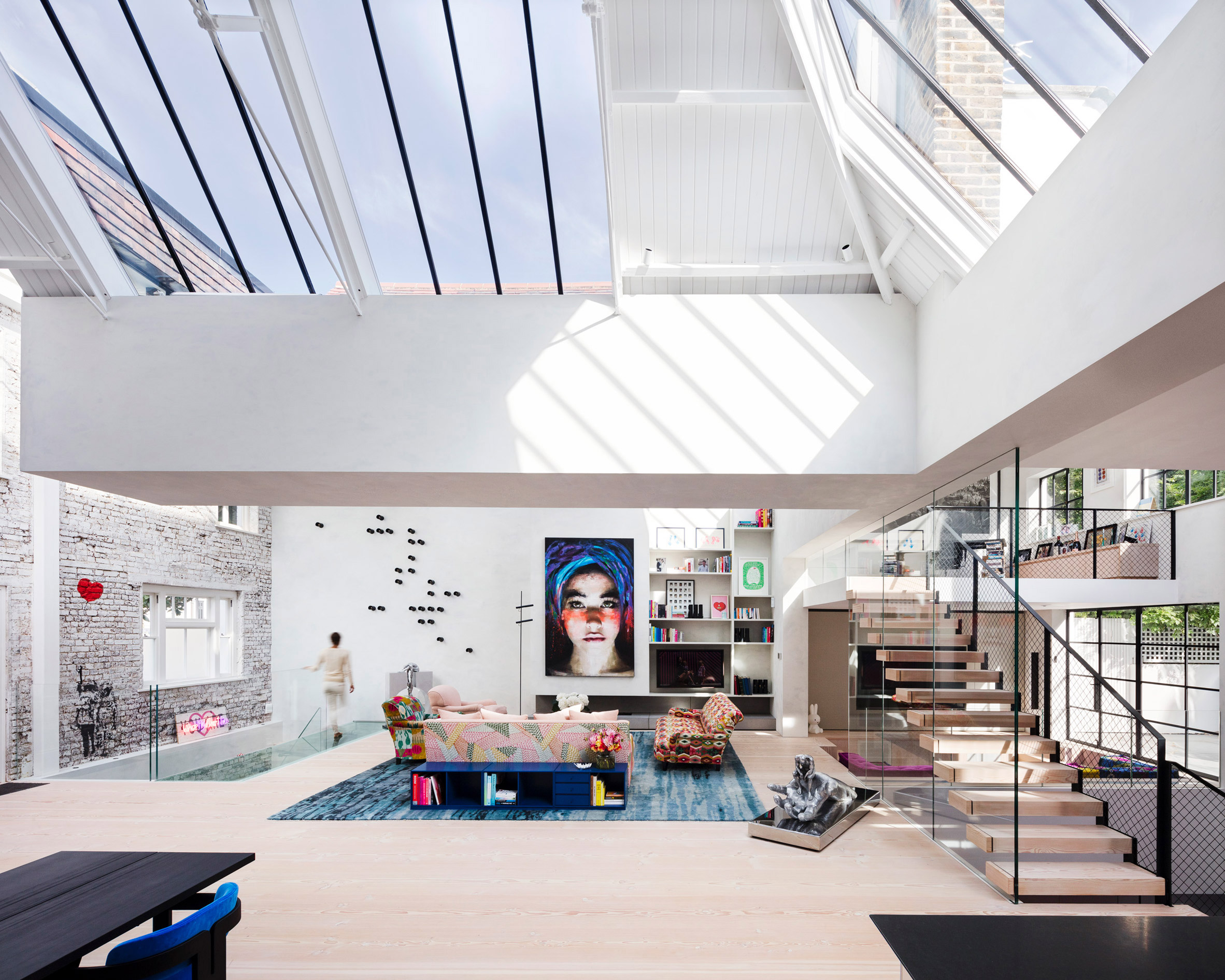 White loft space with skylights