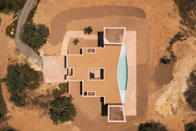 The house was built alongside a pool