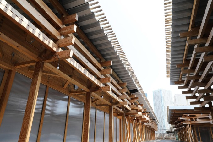 The olympic village plaza has a corrugated roof