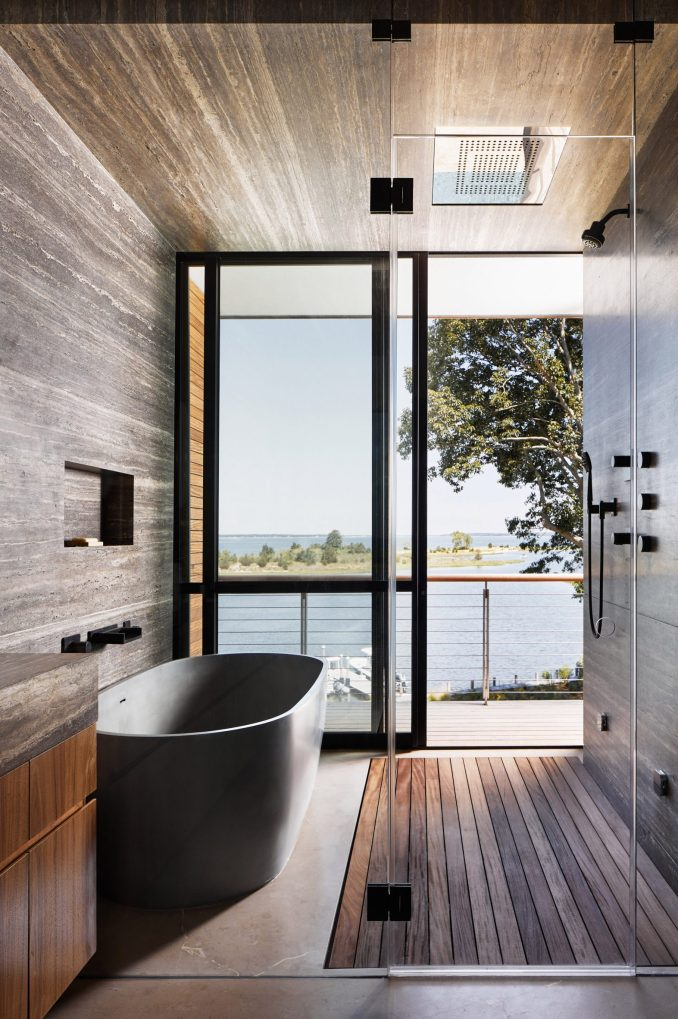 Bathroom with tub and shower that opens onto a balcony