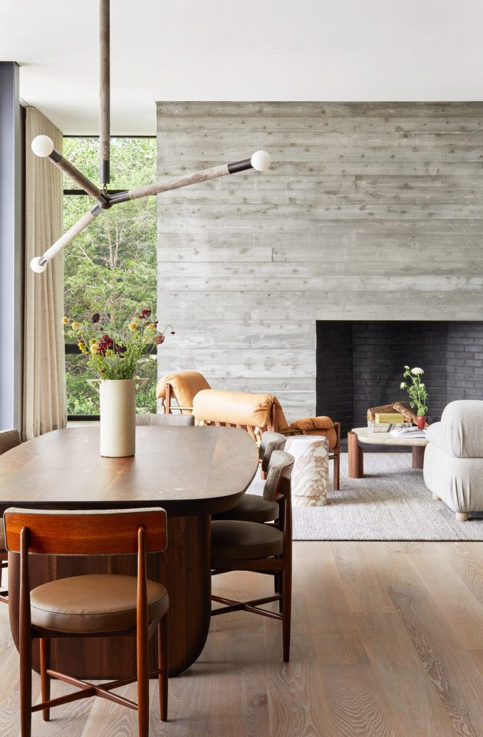 Board-marked concrete fireplace in the interior of a house in the Hamptons