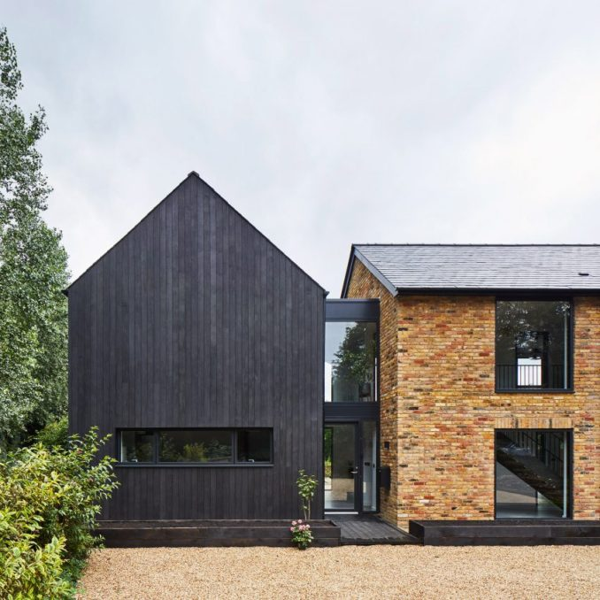 A blackened-timber house extension