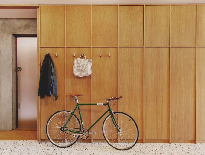 Entrance with oak cupboards in St John Street warehouse apartment by Emil Eve Architects