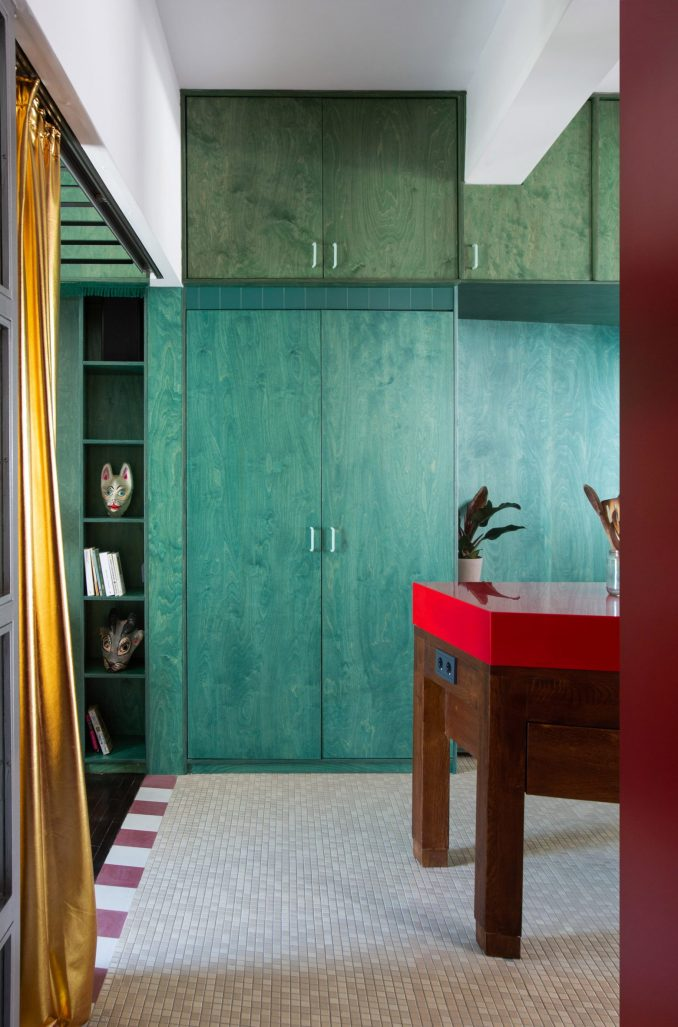 Green built-in storage in interior by Point Supreme Architects