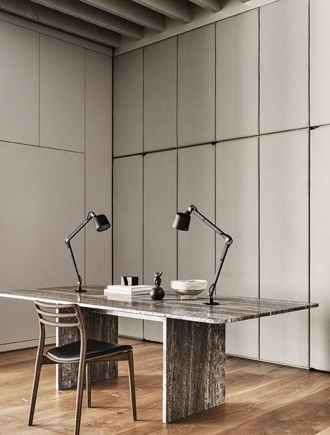 Office with custom travertine desk