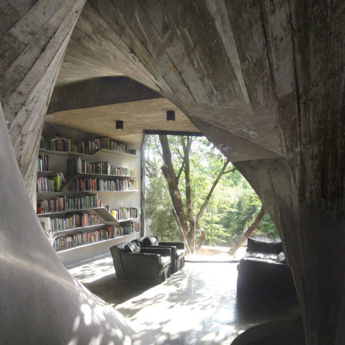 The living area has concrete walls