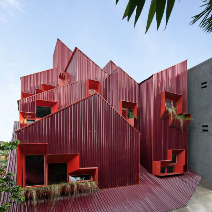Exterior of Stack by Step Red Zone Boarding House by Ismail Solehudin Architecture