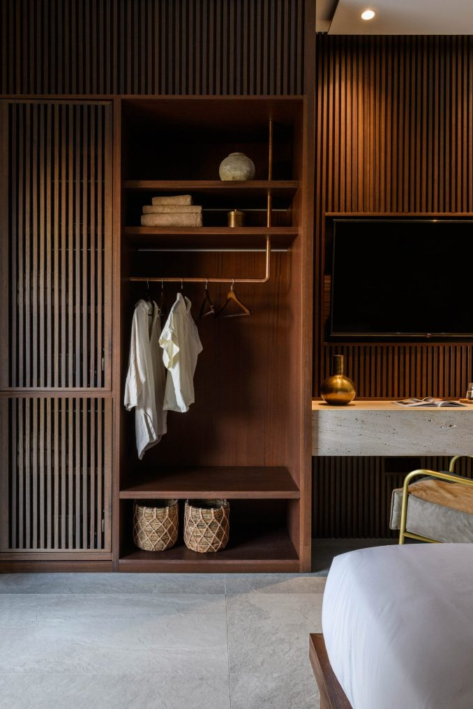 Wood-panelled bedroom with built-in wardrobe in Mykonos Wellness Resort