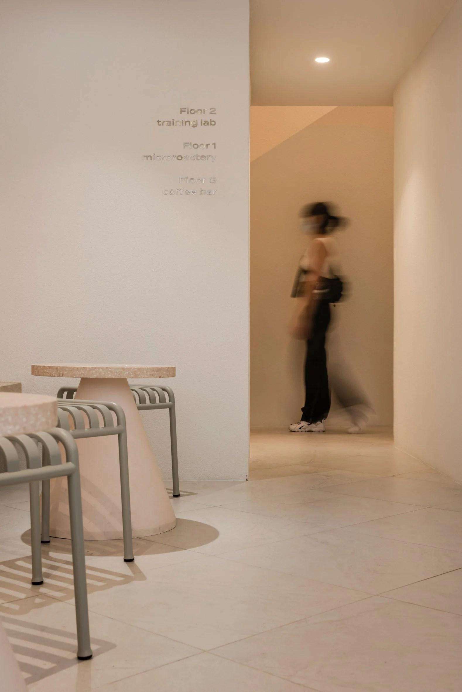 Woman walking through Paga cafe