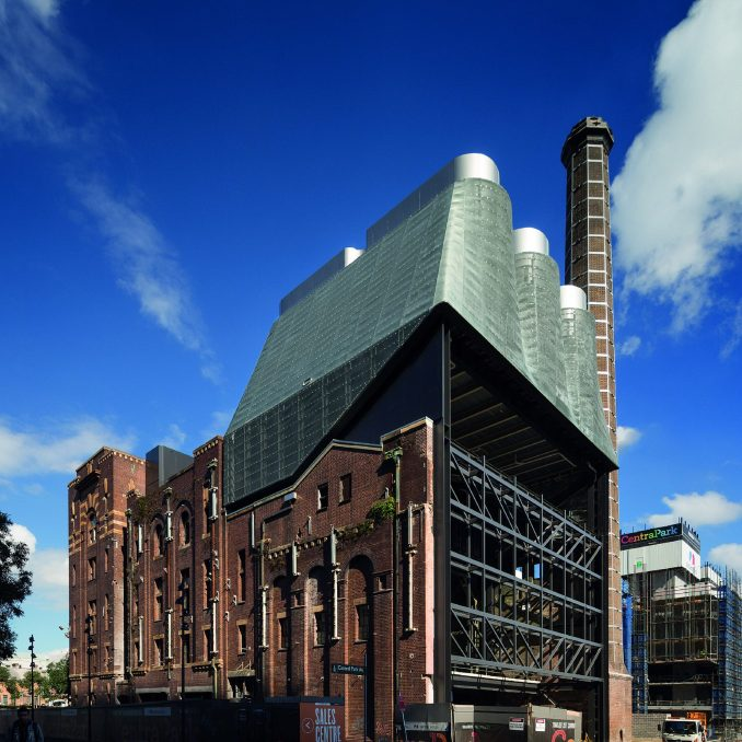 The power plant is clad in green zinc mesh