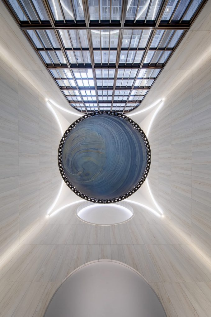 The installation at 550 Madison is a large blue sphere