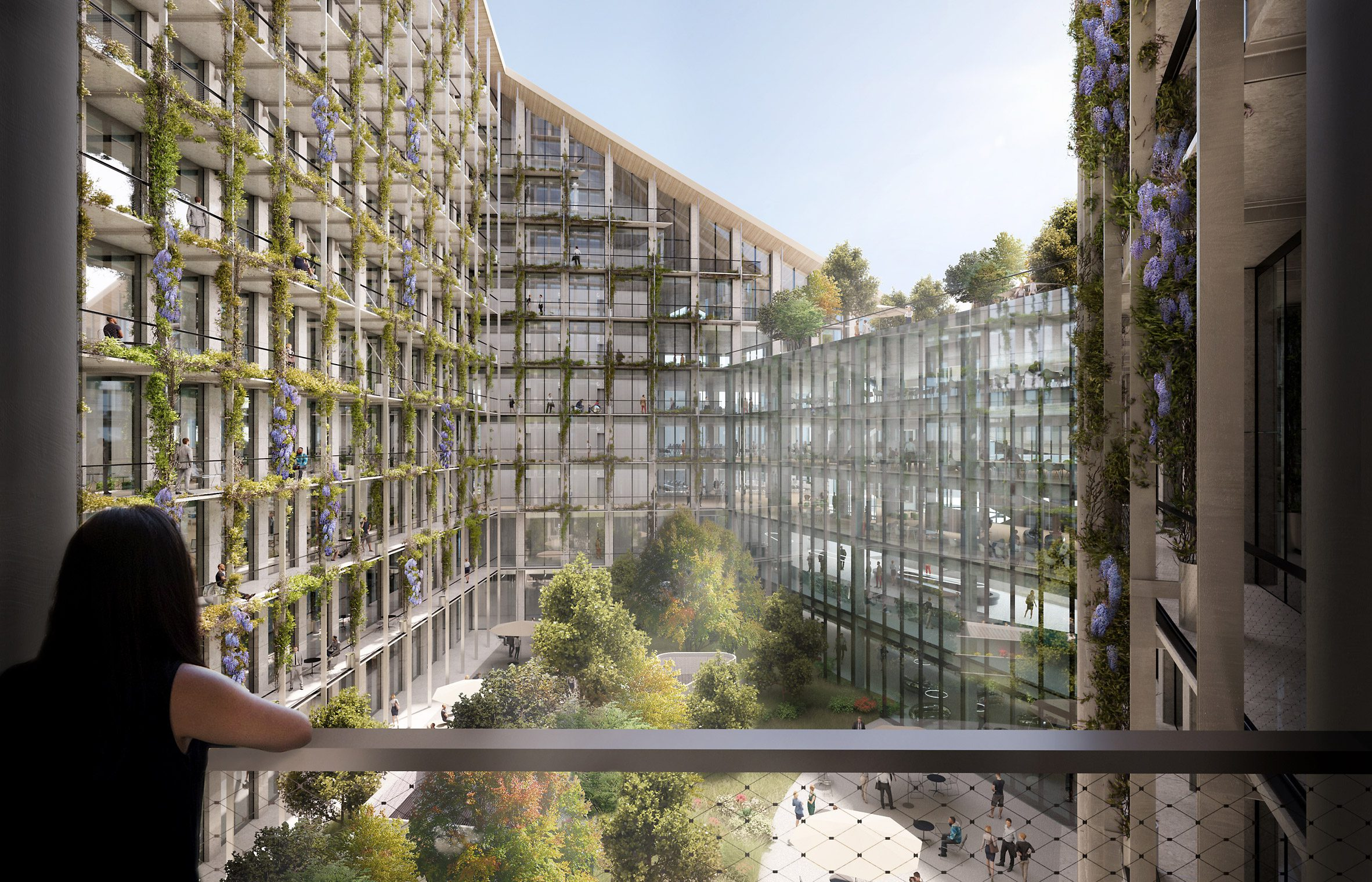 a person stands on the balcony overlooking an internal courtyard within the CityWave building