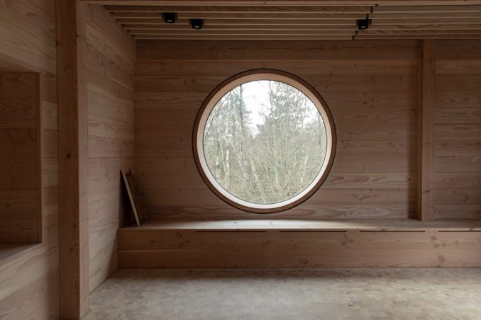 Circular window in Danish timber school by ReVærk