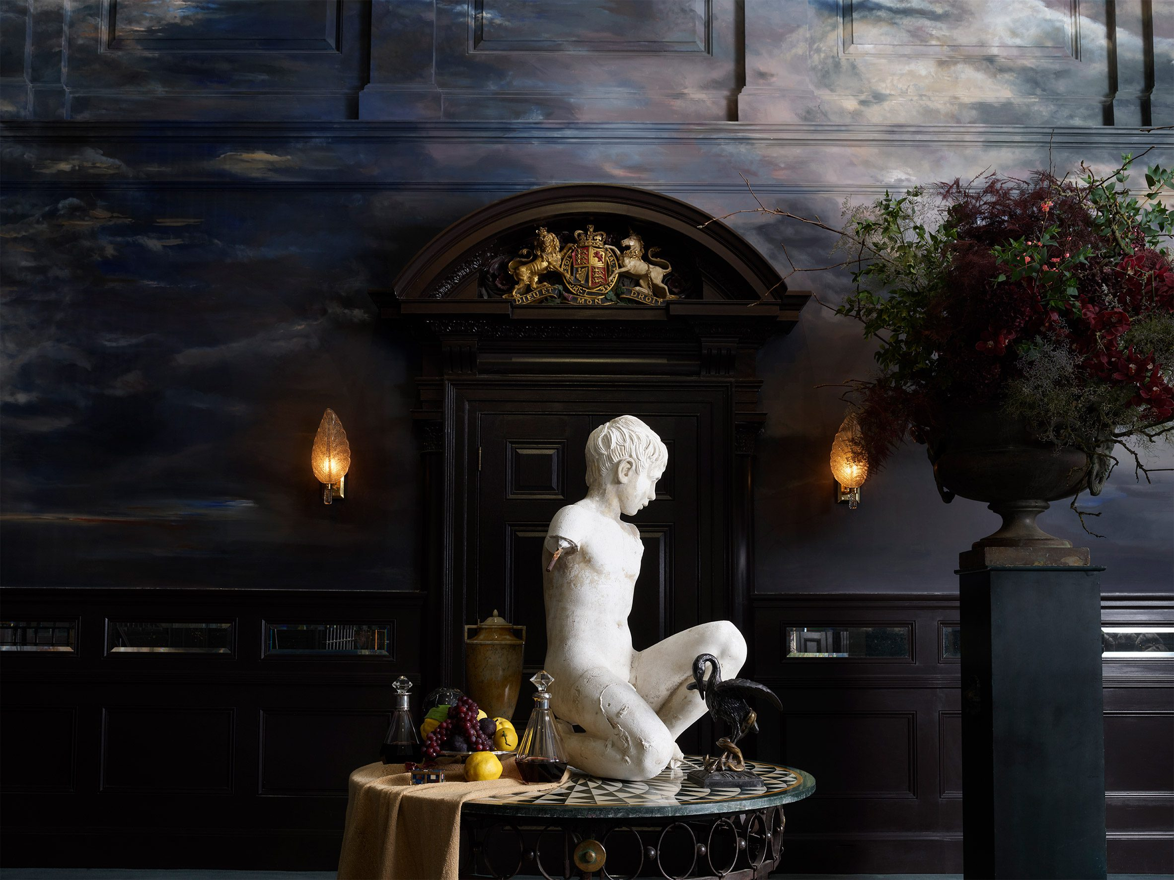 Statue with still life in ballroom of NoMad London hotel