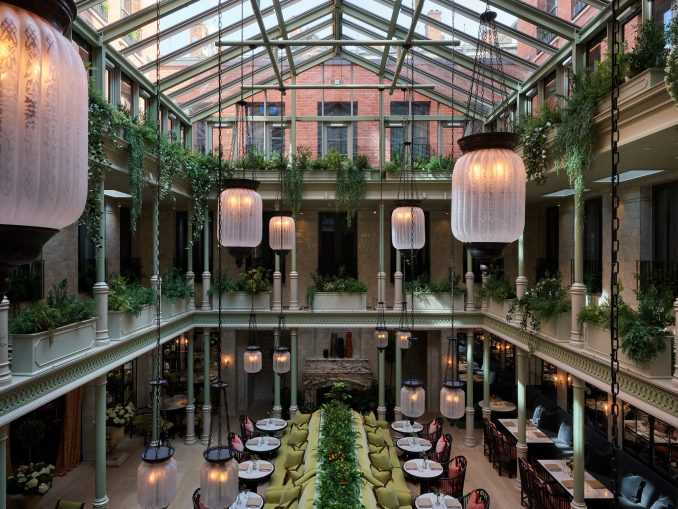 Glass-roofed dining room of NoMad London