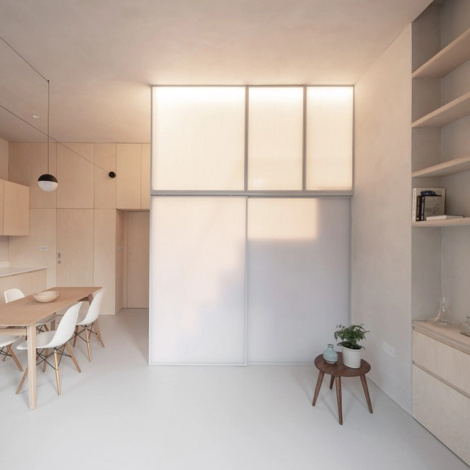 A micro-apartment with an enclosed sleeping area