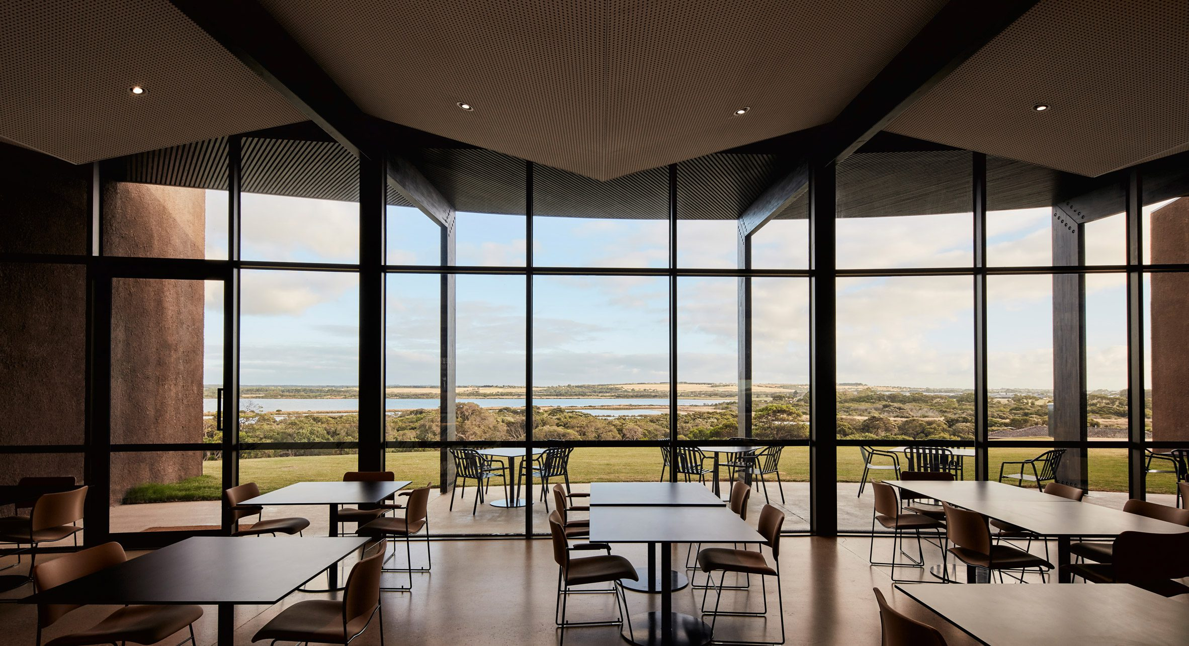 Folded panels clad the ceiling of Lonsdale Links golf club