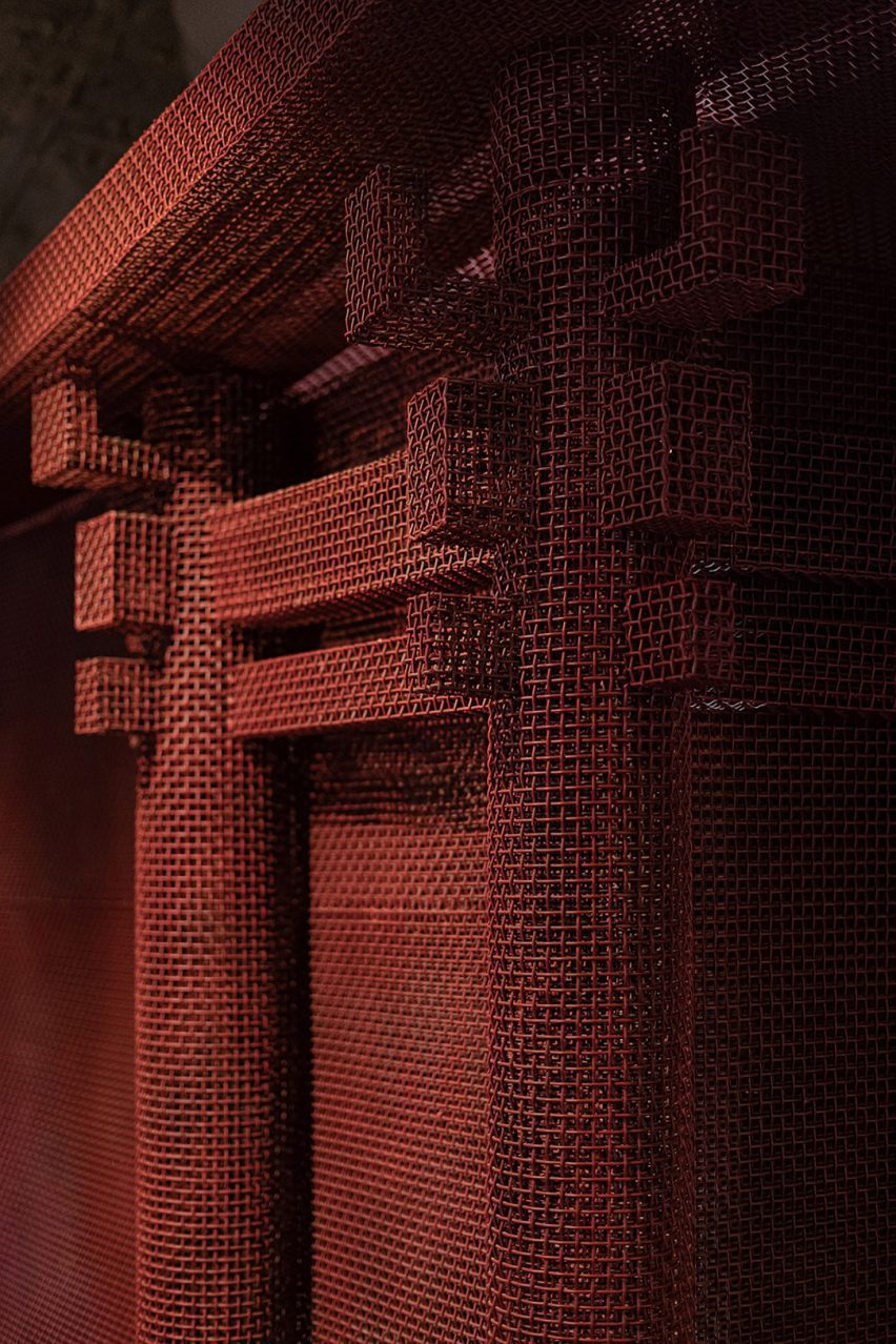 Red metal mesh was shaped into architectural forms