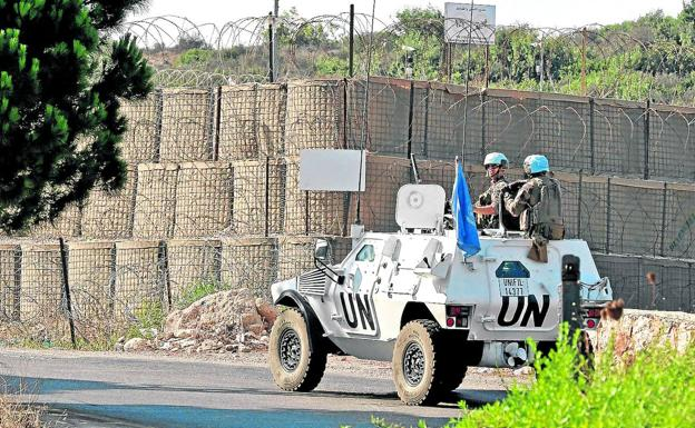 A UN Blue Helmets armored vehicle patrols the border between Lebanon and Israel.