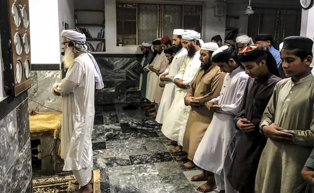 Mullah Abdul Aziz, heart of the Red Mosque, leads prayers at the Jamea Hafsa temple.