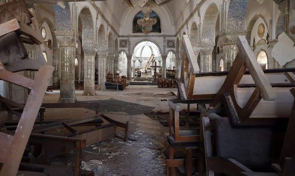 Im Oktober wurde die Stadt Karakosch im Irak von der IS-Besatzung befreit. Den christlichen Gläubigen bot sich ein Bild der Verwüstung. Die muslimischen Terroristen hatten die Gotteshäuser schwer beschädigt. Karakosch war die größte christliche Stadt im Irak. / Bild: APA/AFP/THOMAS COEX