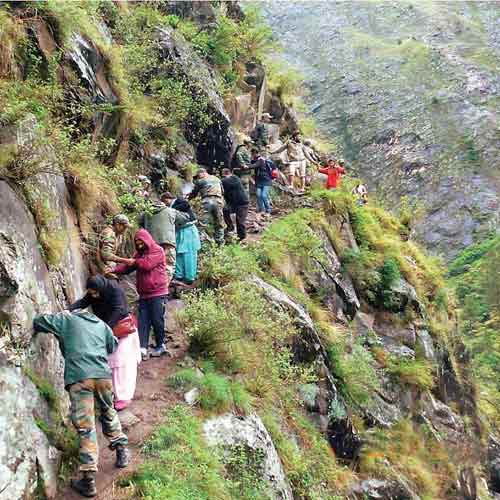 A file photo of stranded tourists being rescued by army personnel in Uttarakhand. The rescue operation is one of the largest in several decades. Courtesy: Indian Army