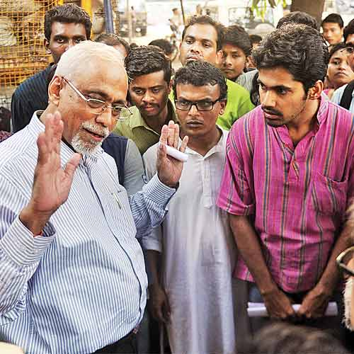 TISS director S Parshuraman talks to student activists outside the Trombay police station on Thursday.