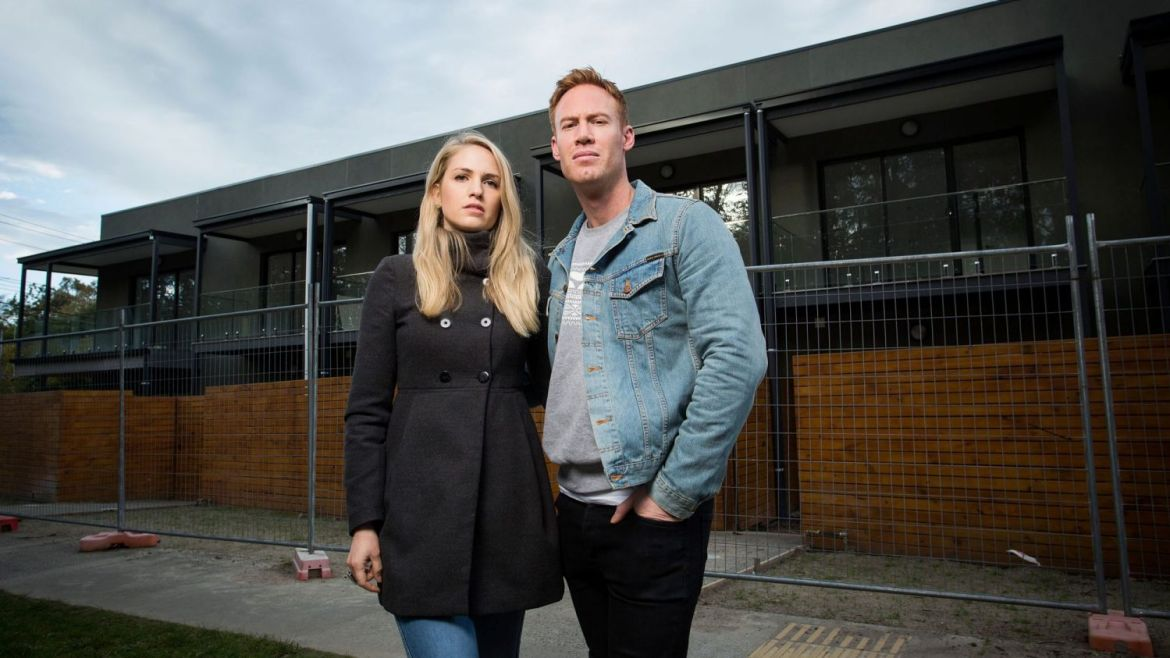 Edward Roberts and Jade Walker in front of the Croydon development they bought off-the-plan.