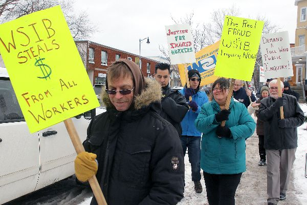 About a dozen injured workers and their supporters marched to Liberal MPP Michael Gravelle's office on Monday to protest WSIB practices.