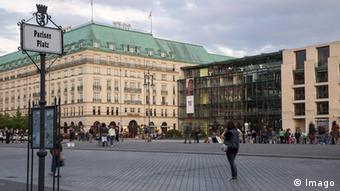 Berlin's Academy of the Arts with people on square in front.