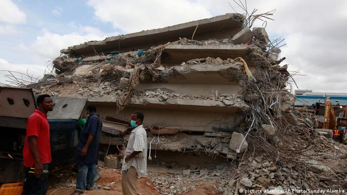 Rescue workers search for survivors in the rubble of a collapsed building belonging to the Synagogue Church of All Nations in Lagos, Nigeria