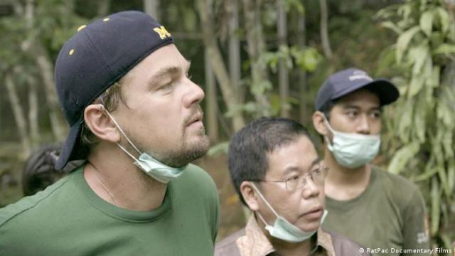 Leonardo DiCaprio (left) and two men in Before the Flood