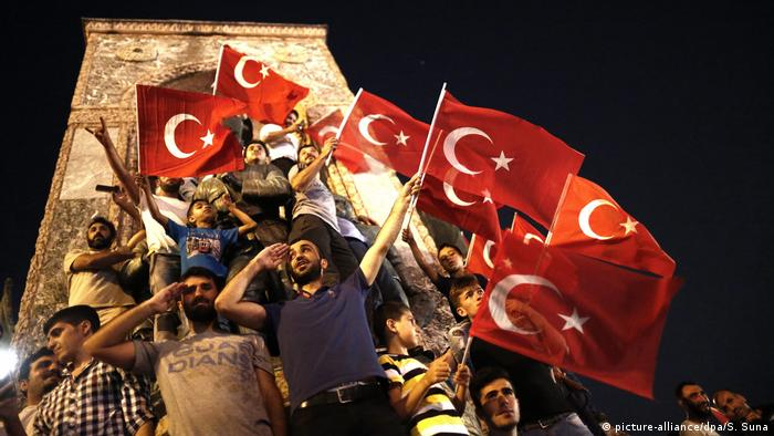 Turks with the Turkish flag.