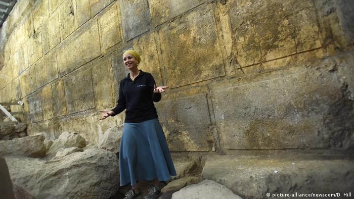 Archaeologist Tehillah Lieberman stands before the Wailing Wall