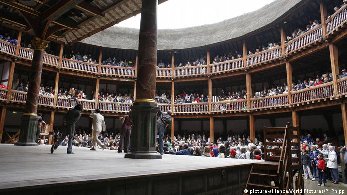 a theater stage with a large audience