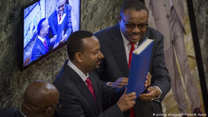 Prime Minister Abiy Ahmed holds the Ethiopian constitution