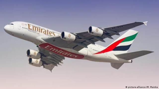 An A380 from Emirates. Impossible to see from the outside it if is carrying passengers or cargo