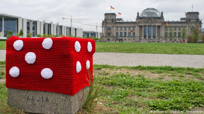 An art event, guerrilla knitting, in front of the Reichstag
