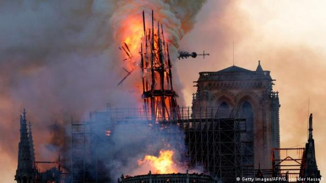 The steeple collapses as smoke and flames engulf the Notre-Dame Cathedral in Paris (Getty Images/AFP/G. van der Hasselt)