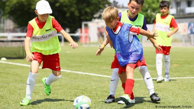 Young boys take part in a football training session