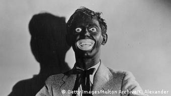 Actor Eddie Cantor wearing black face paint that exaggerates his eyes and mouth