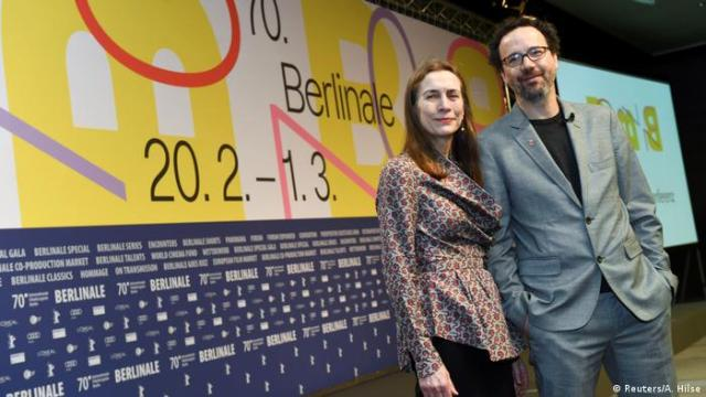 Mariette Rissenbeek and Carlo Chatrian posing at a news conference ahead of the 70th Berlinale International Film Festival in Berlin