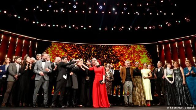 The awarded pose for a family picture after the awards ceremony at the 70th Berlinale International Film Festival in Berlin